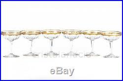Six coupes à Champagne incrustations or en Saint-Louis. Six Champagne saucers